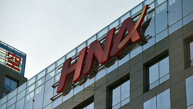 The logo of Chinese conglomerate HNA Group is seen on a building in Beijing, Feb. 18, 2016.