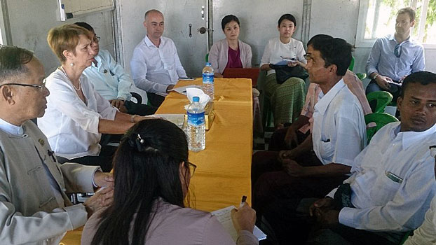 Christine Schraner Burgener (2nd L), the UN's special envoy for Myanmar, accompanied by local officials meets with Muslims who live in the Thet Kel Pyin IDP camps in Sittwe, western Myanmar's Rakhine state, Oct. 16, 2018.